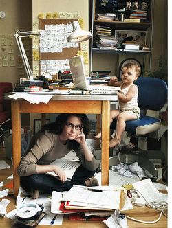 Baby at computer with woman under computer desk