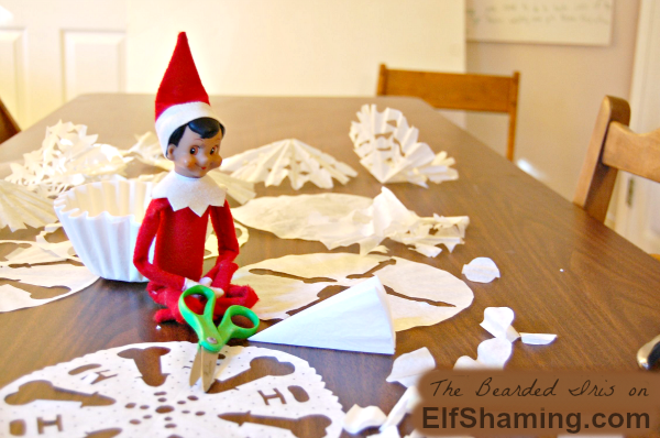 Dobbie-making-snowflakes-Elf-on-the-Shelf-Idea-TheBeardedIris-on-ElfShaming